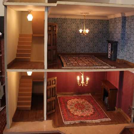 Decorated dolls house with lights installed