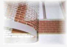 Bricks applied to dolls house using a stencil