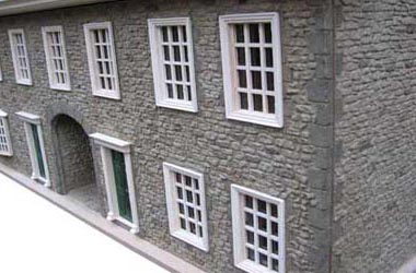 Dolls house kit with stone finish