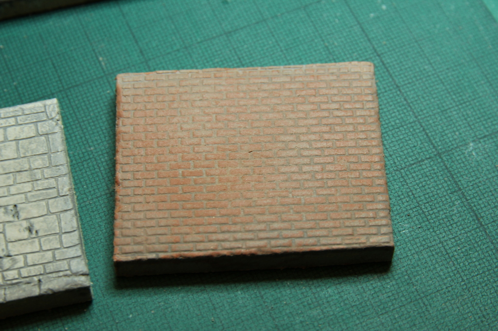 Finished sample of 1:48 scale brick impression on clay